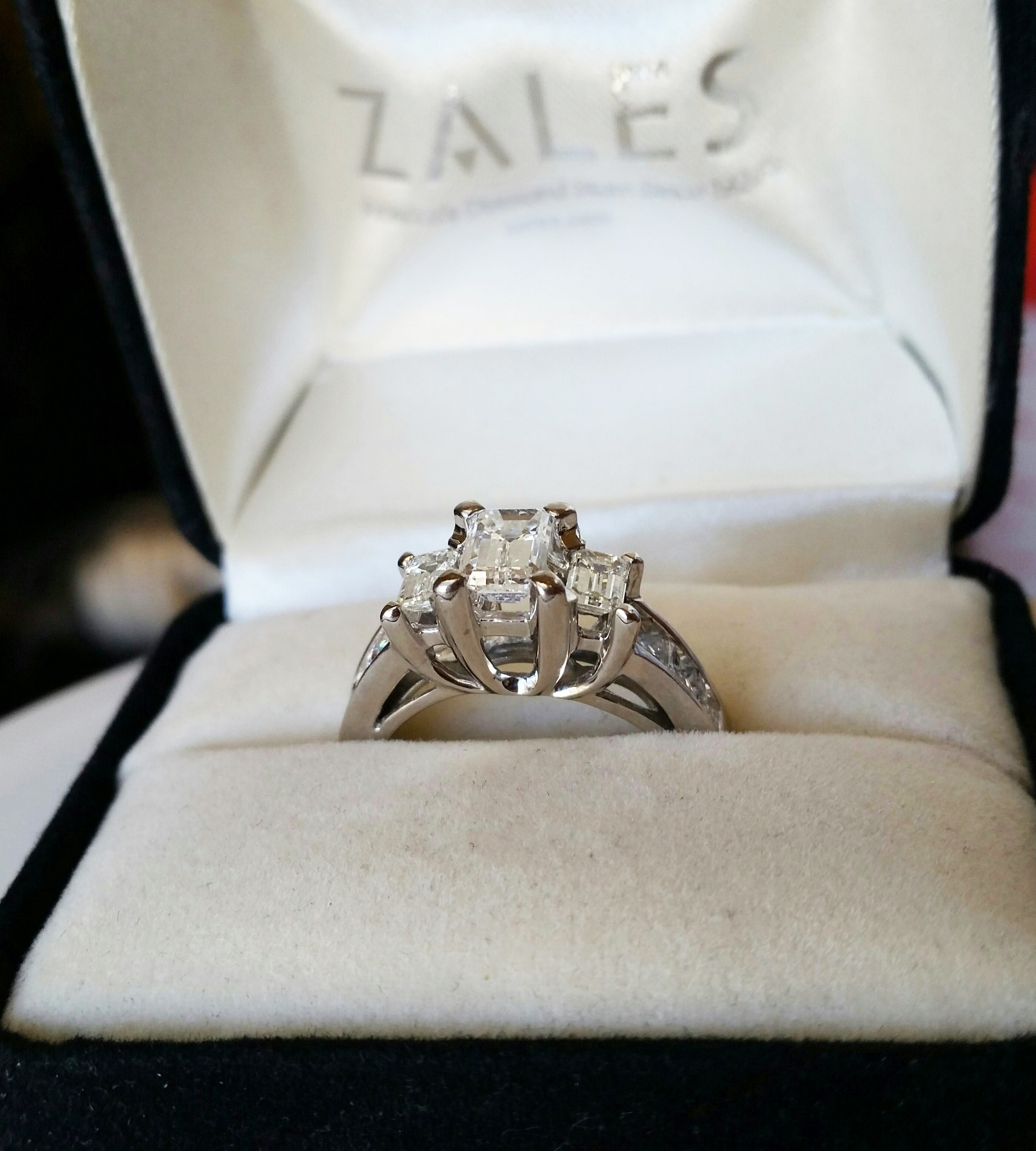 29d290f15f8 3 Stone Emerald-cut 18K White Gold Engagment Ring with 6 channel-set  princess-cut accent diamonds, 2+ CTW GSL Certified (ZALES)