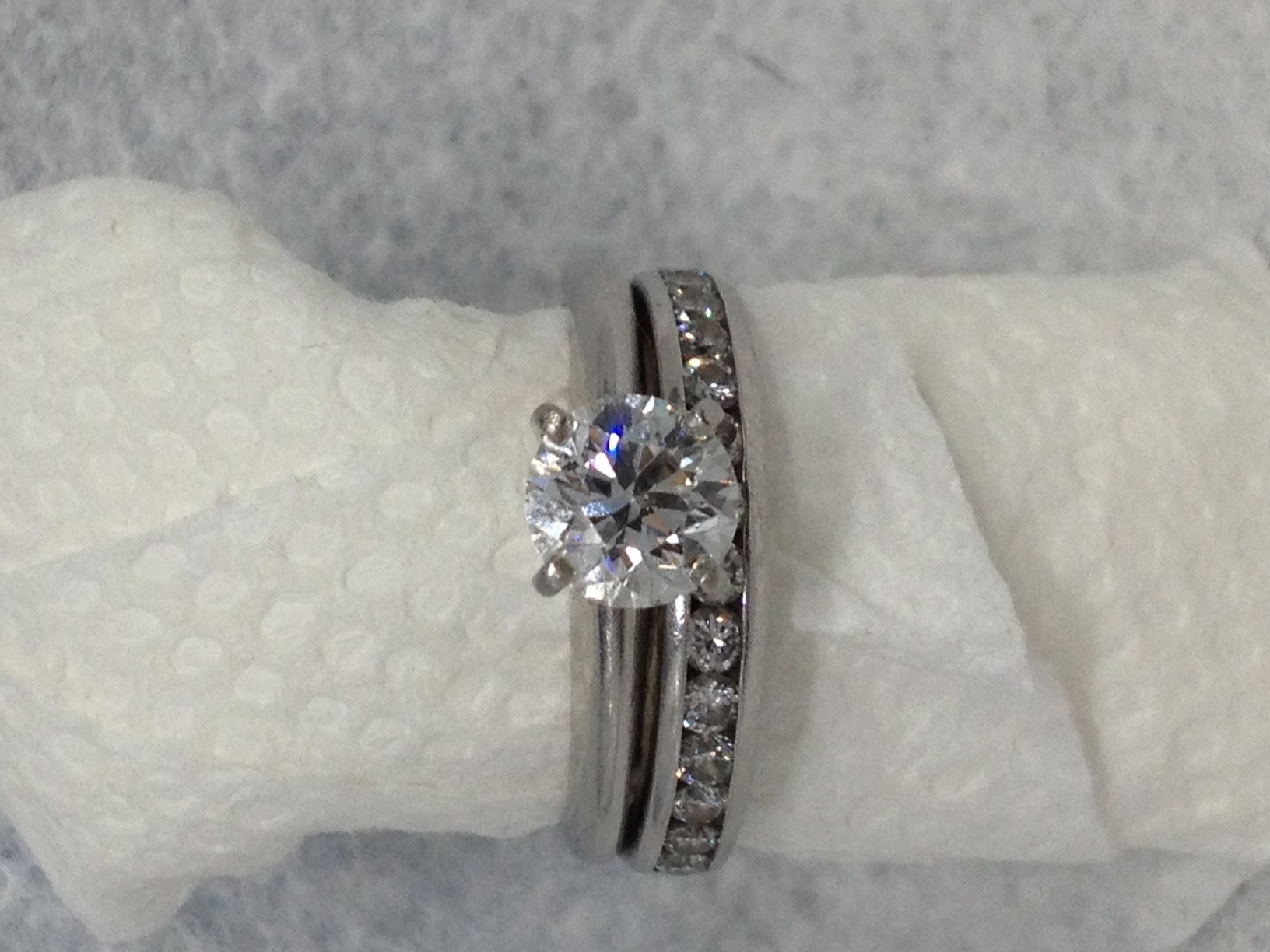 c954fffaf Beautiful solitaire 1.05 carat diamond engagement ring in tiffany platinum  setting with a platinum wedding band containing 14 channel set round  brilliant ...