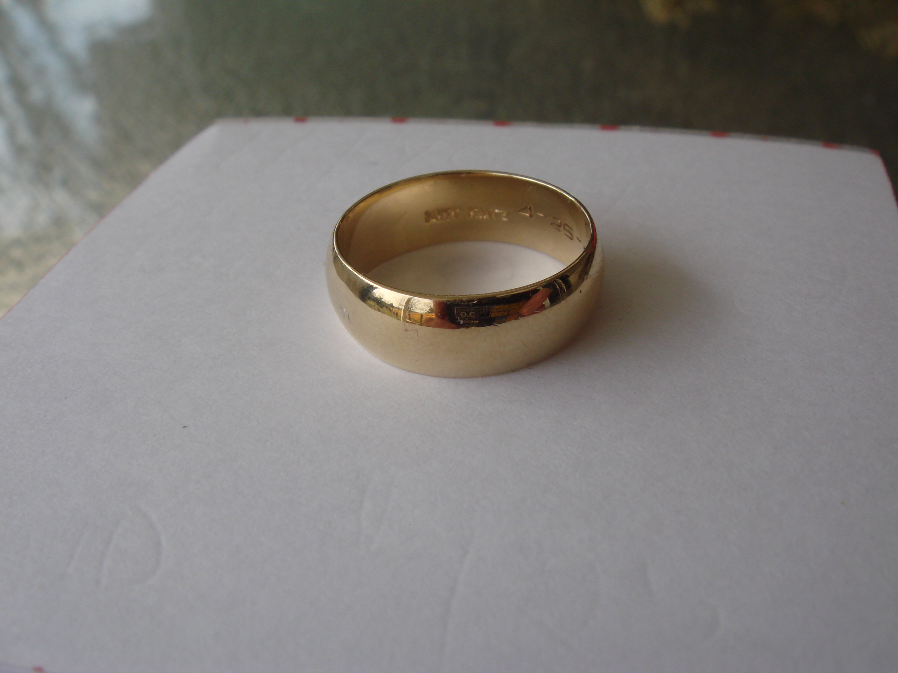 This is an image of 43k Gold Wide Wedding Band