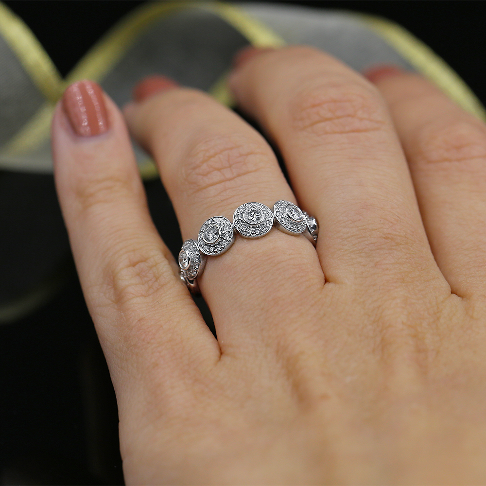 It is a photo of Diamond Eternity Wedding band with total 38.38ct of Round cut Diamonds