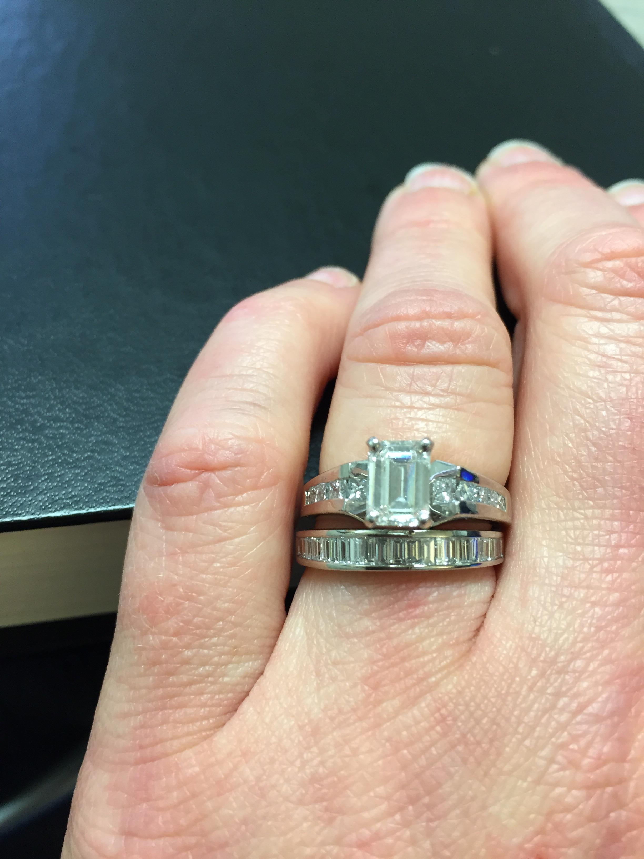It is a picture of Spectacular Emerald Cut Engagement Ring & Wedding Band