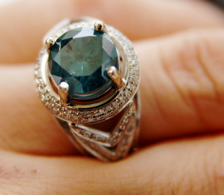 4 98kt blue diamond engagement ring