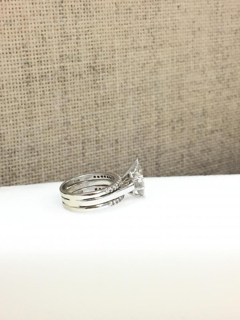 Marquise solitaire with 2