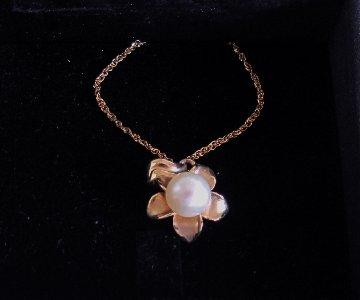 pearl and yellow gold