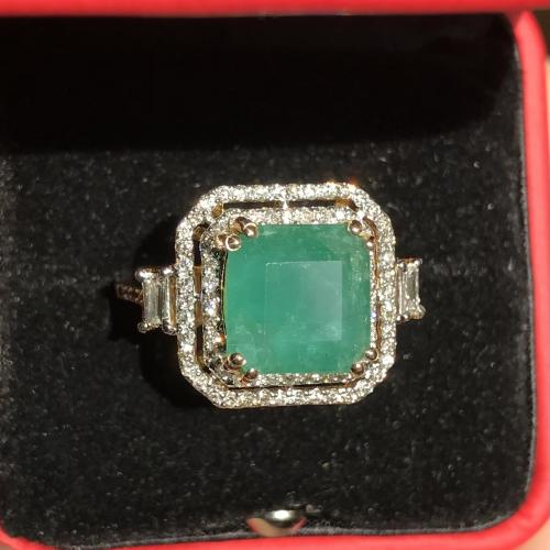 Emerald ring with diamond