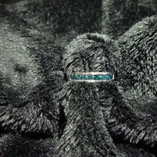 Fancy blue diamond band,